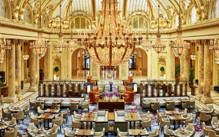 Gold accents all over the ballroom of the Palace Hotel in San Francisco where an event is set up