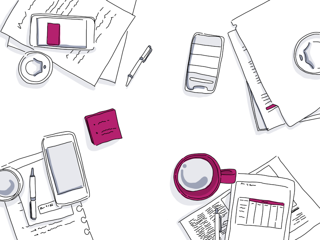 cell phones, coffee mugs and papers on a desk